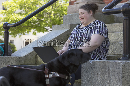 woman with visual impairment sitting with