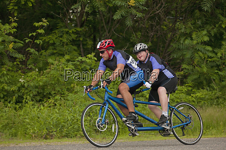 tandem disability racers pilot in front