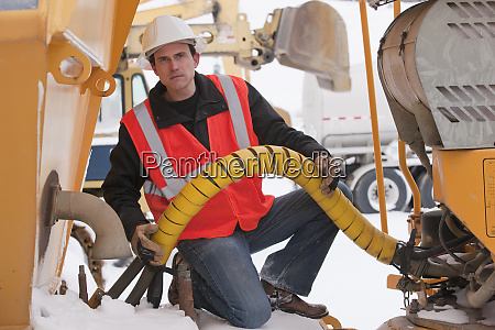 engineer inspecting an earth mover