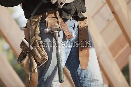 carpenter with tool belt on a