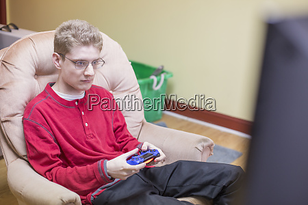 boy with anxiety disorder playing video
