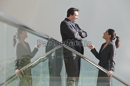 hispanic businesswoman talking with a businessman