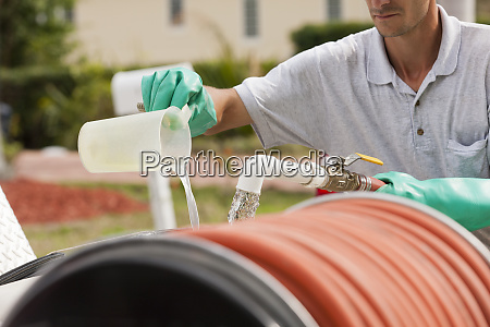 pest control technician mixing chemicals with