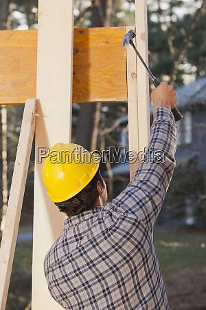 carpenter using a hammer for final