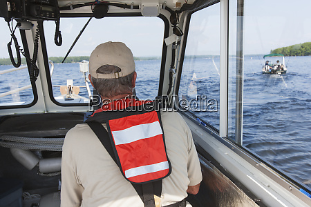public works engineer piloting service boat
