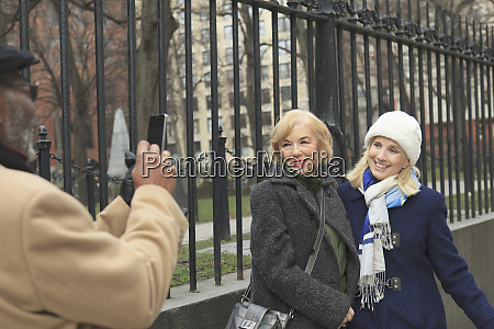 tourists posing for pictures in front