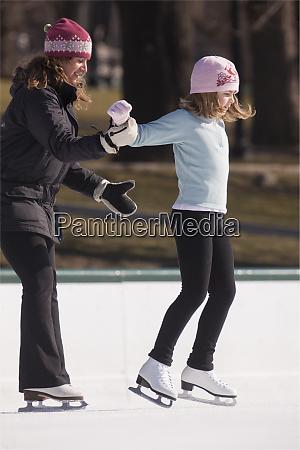female coach helping girl learn to