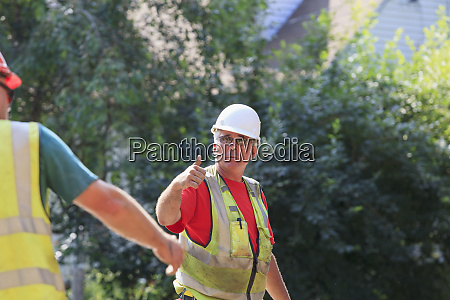 construction supervisor giving thumb up gesture