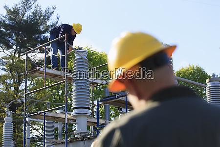 power engineer performing maintenance on fluid