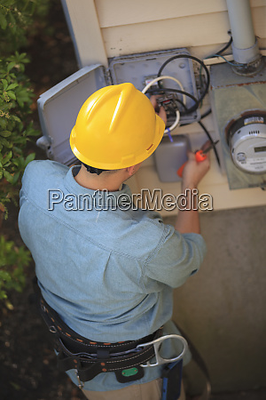 lineman working on cable at connection