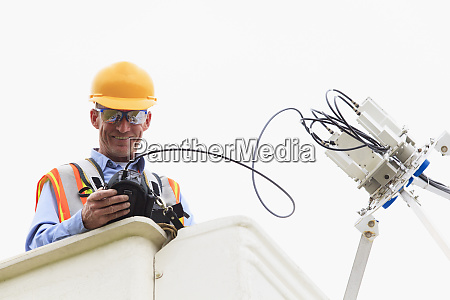 communications engineer measuring signal level at