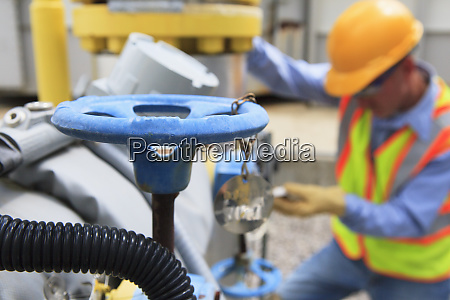 engineer at electric power plant working