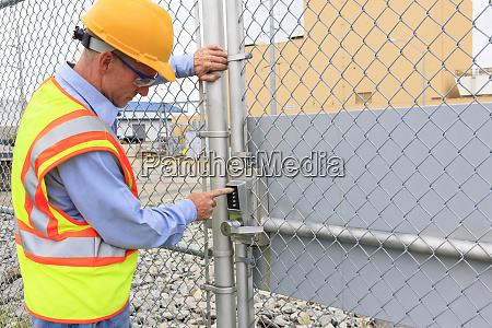electrical engineer using security system to