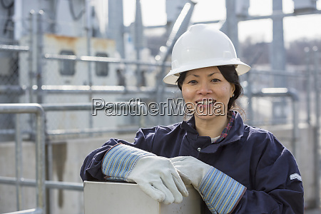 portrait of female power engineer at