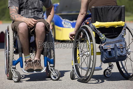 two disability auto racers on wheelchairs