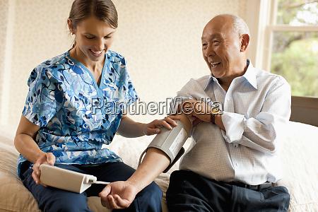 senior man having his blood pressure