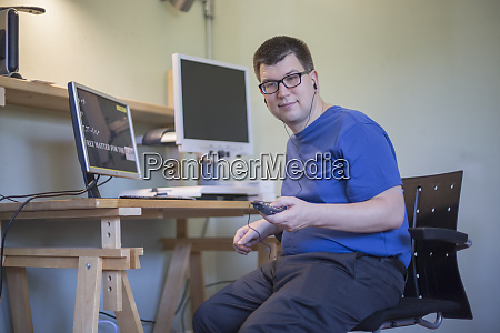 man with visual impairment using his
