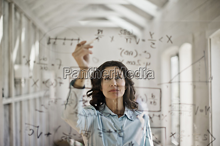 mathmetician working to solve equation