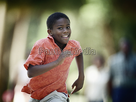 front view a young boy running