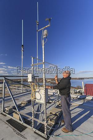 engineer working with weather sensors