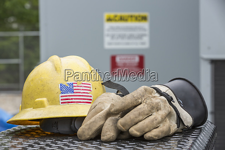 hard hat with rubber protective gloves