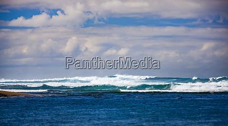 waves breaking in the pacific ocean
