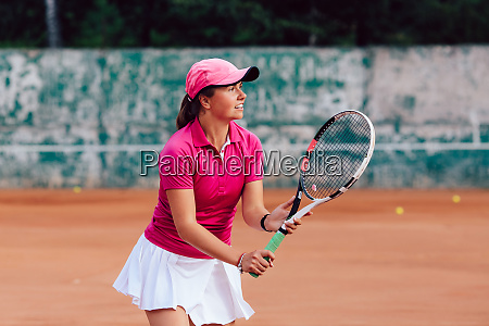 tennis player attractive young woman playing
