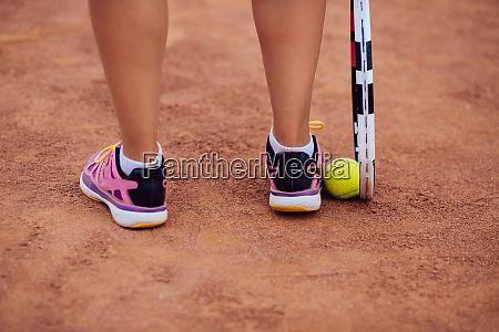 female tennis player standing on the