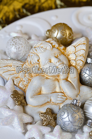 white gold christmas decoration with angel