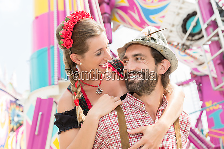 man and woman in tracht on