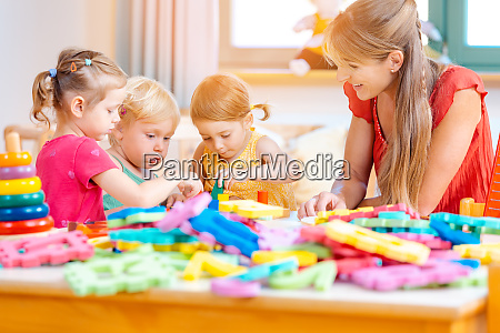 group of children and teacher playing