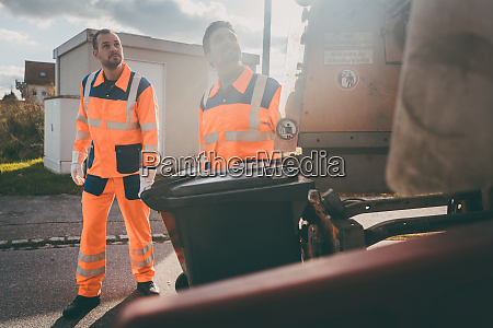 garbage removal men working for a
