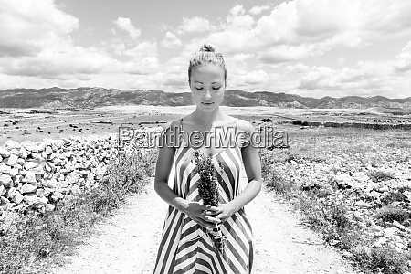 caucasian young woman in summer dress