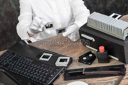 hand photographer digitize film slide for