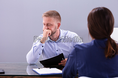 disappointed young man sitting at interview