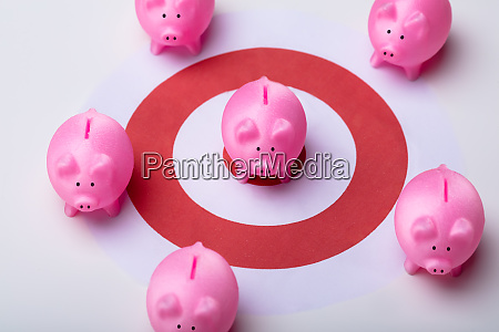 piggy bank and red darts target