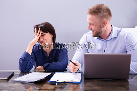 woman sitting new annoying male colleague