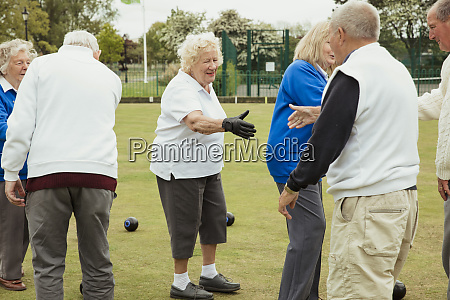 senior adults shaking hands