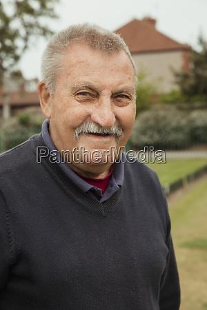 senior man with a moustache