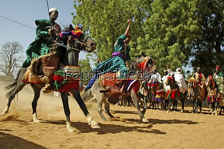 cameroon pouss african horsemen riding a