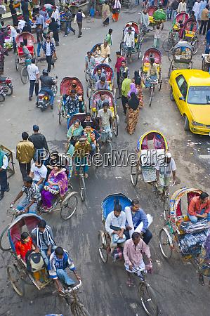 very busy rickshaw traffic on a