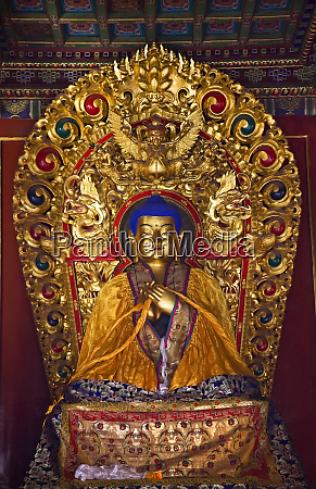 blue buddha yellow scarf altar offerings