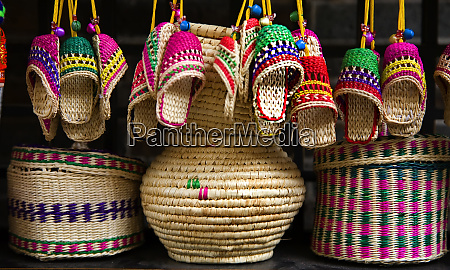colorful straw baskets shoes and other