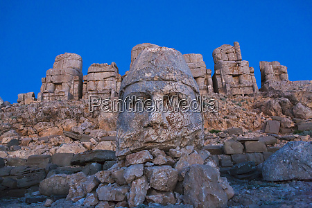 statue of head at sunrise on