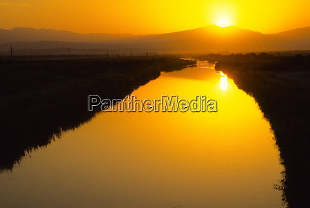 irrigation canal at sunset near ashkhabad