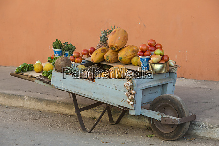 cuba trinidad wheelbarrow with fruit and