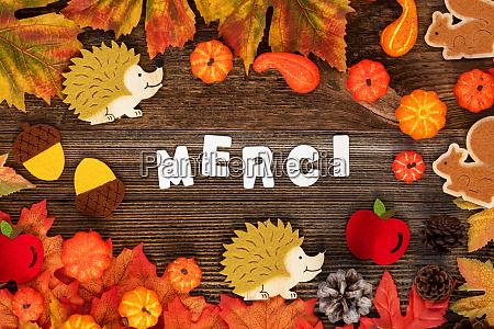 colorful autumn decoration text merci means