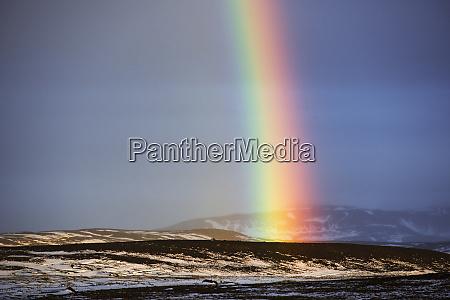 iceland rainbow on landscape
