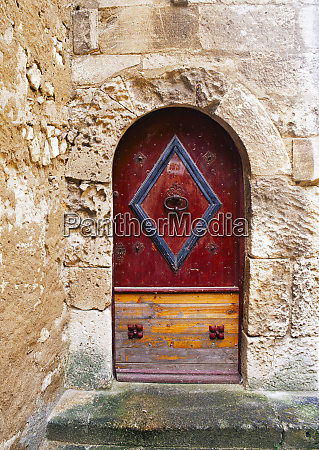 colorful door in the stone wall