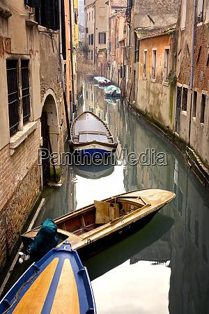 italy venice gondolas moored in canal